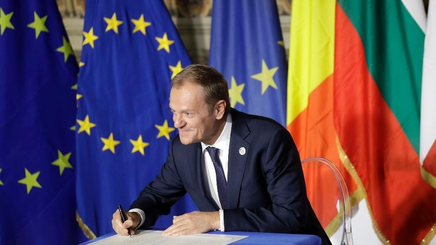 European Council President Donald Tusk signs a declaration during an EU summit meeting at the Orazi and Curiazi Hall in the Palazzo dei Conservatori in Rome on Saturday, March 25, 2017. European Union leaders were gathering in Rome to mark the 60th anniversary of their founding treaty and chart a way ahead following the decision of Britain to leave the 28-nation bloc. (AP Photo/Alessandra Tarantino)