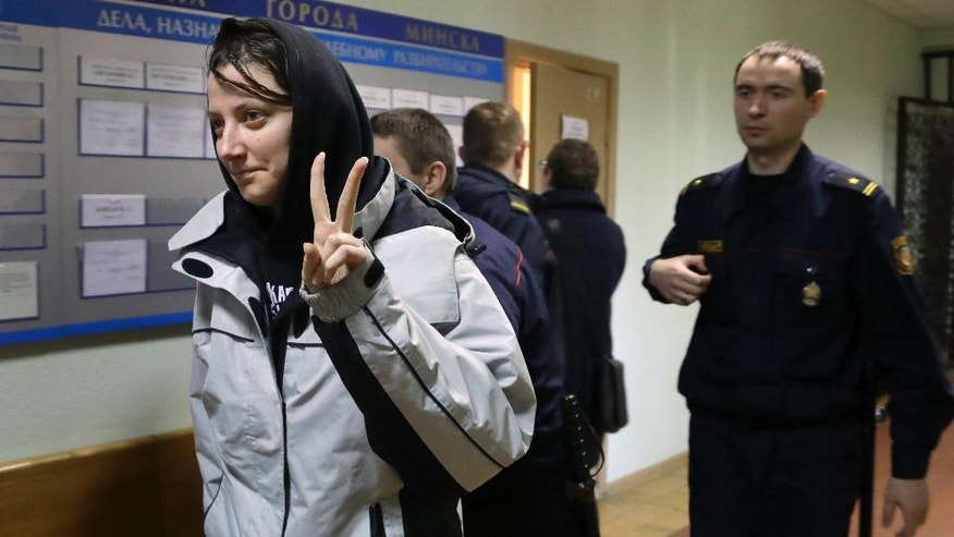 Activist Marina Kostylyanchenko, detained at a rally, is escorted by police officers upon her arrival for a court hearing in Minsk, Belarus, on Monday, March 27, 2017. About 400 people were arrested on Saturday in an unsanctioned protest against the authoritarian government of President Alexander Lukashenko, who has stifled dissent and independent media during his 23 years in power. (AP Photo/Sergei Grits)