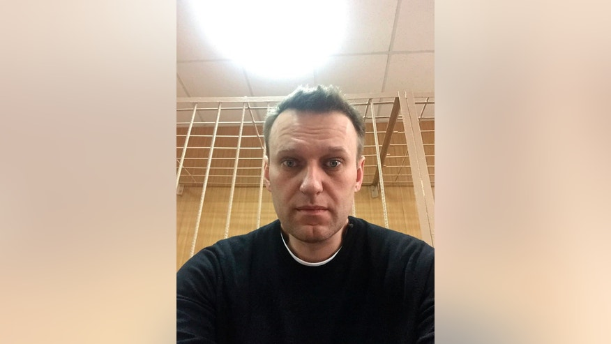 In this handout photo provided by Alexei Navalny, Russian opposition leader Alexei Navalny makes a selfie inside a court room in Moscow, Russia, Monday, March 27, 2017. Russian opposition leader Alexei Navalny is making a court appearance Monday, a day after being detained at a major opposition rally the previous day. Tens of thousands of protesters took to the streets across Russia on Sunday in the biggest show of defiance since the 2011-2012 anti-government protests.(Alexei Navalny/ photo via AP) MANDATORY CREDIT