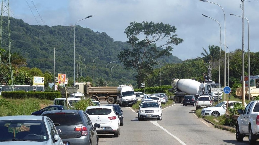 General view of a roadblock set up in Remire-Montjoly near the French Guiana capital, Cayenne, Monday, March 27, 2017. French Guiana faced a nationwide strike Monday over crime and economic difficulties, amid protests that have paralyzed the French territory in South America, halted flights and a rocket launch and prompted a U.S. travel warning. (Deborah Neusy/France Guyane via AP)