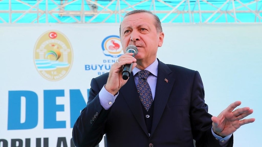Turkey's President Recep Tayyip Erdogan addresses his supporters in Denizli, Turkey, Friday, March 24, 2017. Erdogan has hit out at the head of Germany's intelligence service for comments suggesting that Berlin was not convinced over U.S.-based cleric Fethullah Gulen's role in Turkey's failed coup. (Kayhan Ozer/Presidential Press Service, Pool Photo via AP)