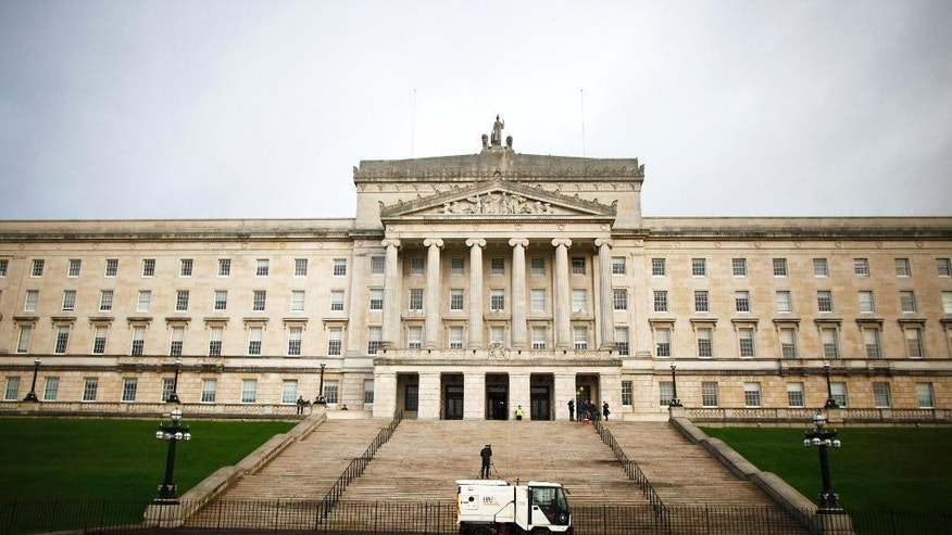 FILE - In this Monday, Jan. 16, 2017 file photo, a road sweeper van passes Stormont, Belfast, Northern Ireland. The British government is facing a deadline Monday March 27, 2017, on whether to extend negotiations on Northern Ireland's political future or renew direct control from London. (AP Photo/Peter Morrison, File)