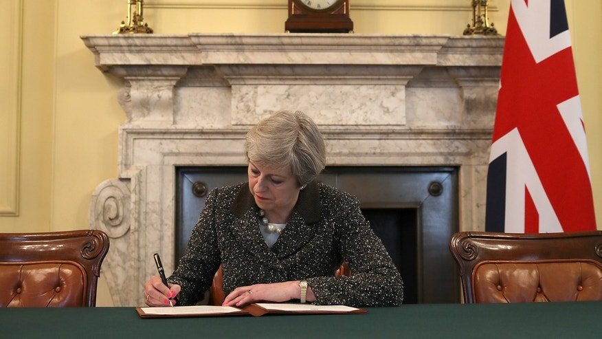 British Prime Minister Theresa May in the cabinet office signs the official letter to European Council President Donald Tusk invoking Article 50 and the United Kingdom's intention to leave the EU.