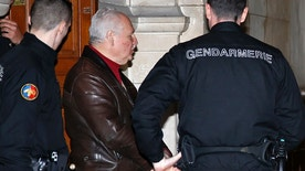 "Ilich Ramirez Sanchez, known as ""Carlos the Jackal"", is surrounded by French gendarmes as he leaves the Paris courthouse March 3, 2014. Carlos the Jackal, the Marxist militant once ranked among the world's most wanted criminals, who currently serves a life sentence in prison, is at court for anti-Semitic insults he made towards a female prison officer. The Venezuelan has been locked up in France for almost 20 years serving an initial life sentence for killing two police officers and an informant in Paris in 1975. REUTERS/Jacky Naegelen (FRANCE - Tags: CRIME LAW) - RTR3FZFC"