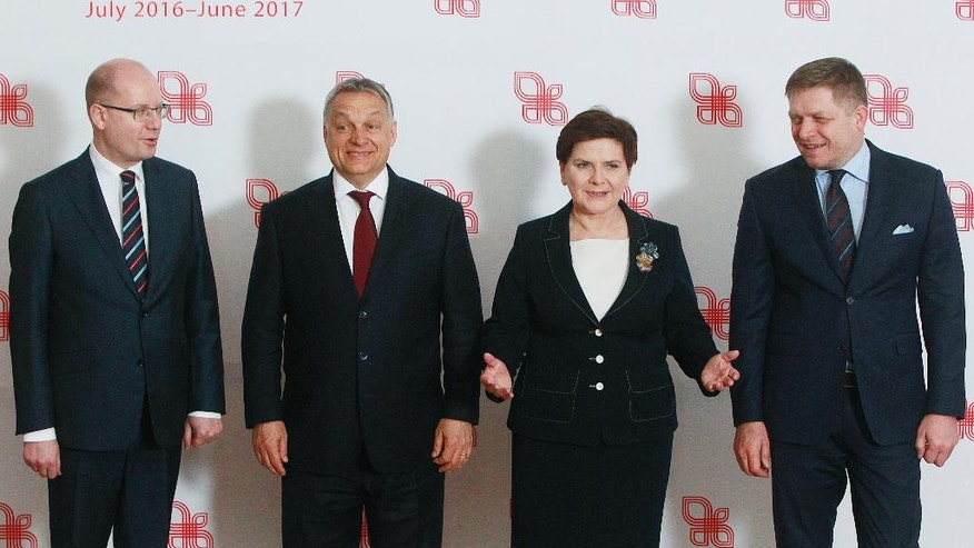 Prime ministers of the Visegrad group countries, from left, Czech Republic's Prime Minister Bohuslav Sobotka, Hungarian Prime Minister Viktor Orban, Polish Prime Minister Beata Szydlo and Slovakian Prime Minister Robert Fico pose for media before their meeting in Warsaw, Poland, Tuesday, March 28, 2017. (AP Photo/Czarek Sokolowski)
