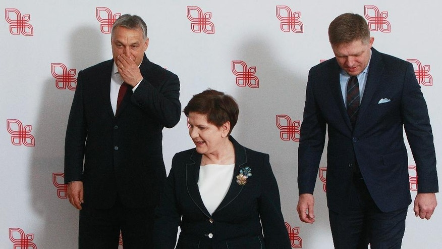 Prime ministers of the Visegrad group countries, from left, Hungarian Prime Minister Viktor Orban, Polish Prime Minister Beata Szydlo and Slovakian Prime Minister Robert Fico leave  after posing for media before their meeting in Warsaw, Poland, Tuesday, March 28, 2017. (AP Photo/Czarek Sokolowski)
