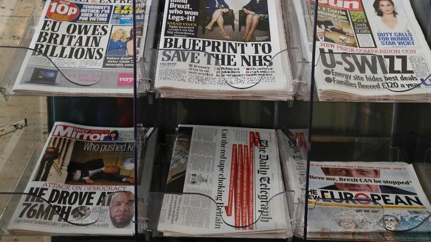 "Newspapers are seen displayed for sale in London, Tuesday, March 28, 2017. Britain's Daily Mail newspaper has sparked complaints with a front page photograph focusing on the legs of Prime Minister Theresa May and Scottish First Minister Nicola Sturgeon. The photo of the two leaders published Tuesday displays their legs prominently alongside a headline speculating about which leader won the ""Legs-it"" competition — a play on Brexit. (AP Photo/Kirsty Wigglesworth)"