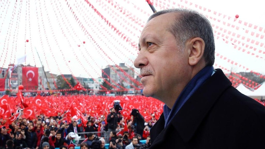 FILE - In this Saturday, March 11, 2017 file photo, Turkey's President Recep Tayyip Erdogan addresses his supporters during a rally for the upcoming referendum in Istanbul. Times have been hard for Turkey, buffeted by bombings, violence between government forces and Kurdish rebels, refugee flows from the war in neighbouring Syria and a failed coup attempt that unleashed a huge crackdown under an ongoing state of emergency. On April 16, 2017, Turks will decide whether to make the post of president more powerful in a constitutional referendum that is a big gamble for tough-talking Erdogan. (Kayhan Ozer/Pool Photo via AP, file)