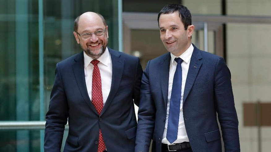 Socialist candidate for the presidential election in France Benoit Hamon, right, and the chairman of the German Social Democratic Party Martin Schulz, left, arrive for a press statement after a meeting at the party's headquarters in Berlin, Germany, Tuesday, March 28, 2017. (AP Photo/Michael Sohn)