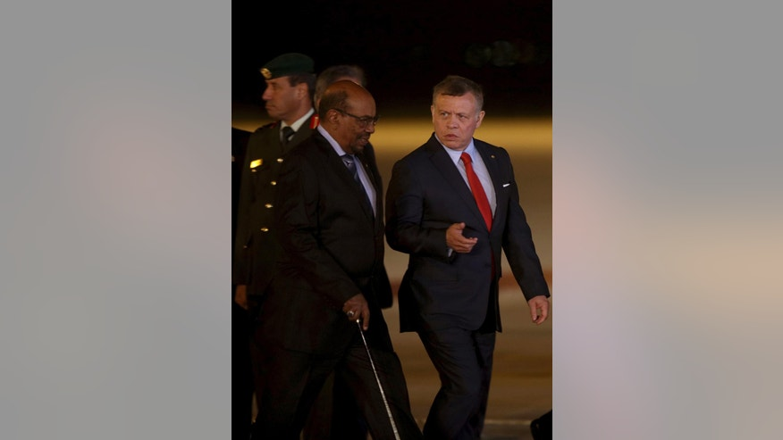Jordan's King Abdullah II, right, greets Sudan's President Omar al-Bashir upon his arrival at Queen Alia International Airport in Amman, Jordan, Tuesday, March 28, 2017.  Sudan's president, sought by the International Criminal Court on war crimes charges, has been welcomed in Jordan, despite calls by human rights groups to deny him entry. Omar al-Bashir is among 21 Arab leaders gathering for a summit. (AP Photo/Raad Adayleh)