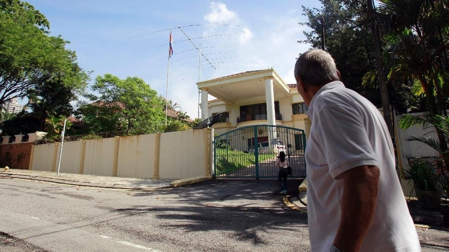 A man walks near the North Korean Embassy in Kuala Lumpur, Malaysia Tuesday, March 28, 2017. Kim Jong Nam, the half brother of North Korean leader Kim Jong Un, died after two women smeared his face with the banned VX nerve agent at Kuala Lumpur's airport on Feb. 13, 2017, according to Malaysian authorities. Relations between Malaysia and North Korea have deteriorated sharply since Kim's death. (AP Photo/Daniel Chan)