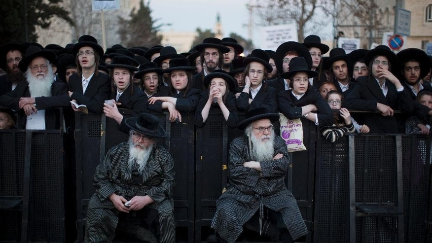 Ultra-Orthodox Jews take part in a protest against Israeli army conscription in Jerusalem, Tuesday, March 28, 2017. Ultra-Orthodox leaders say they serve the Jewish nation through religious study and prayer and fear integration in the army threatens their insular, pious lifestyle. (AP Photo/Oded Balilty)