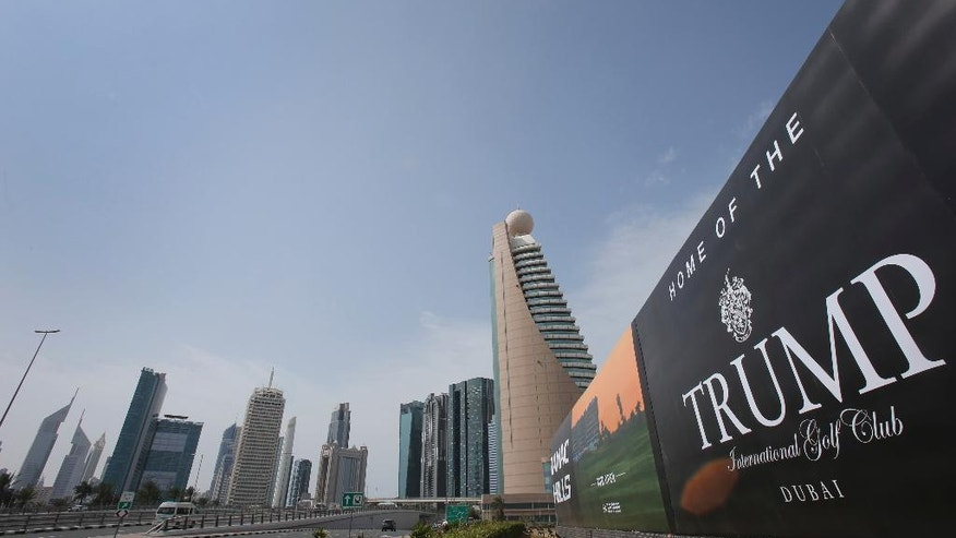 FILE - In this Saturday, Feb. 18, 2017 file photo, a giant billboard advertising the Trump International Golf Club hangs at the Dubai Trade Center roundabout, in Dubai, United Arab Emirates. Donald Trump holds a trademark in Jordan for a casino in his name despite gambling being illegal in the kingdom _ one of four he received in the years before he became America's president, The Associated Press has learned. The trademarks suggest Trump, a former casino executive, may have had wider hopes for the Middle East than previously known.(AP Photo/Kamran Jebreili, File)