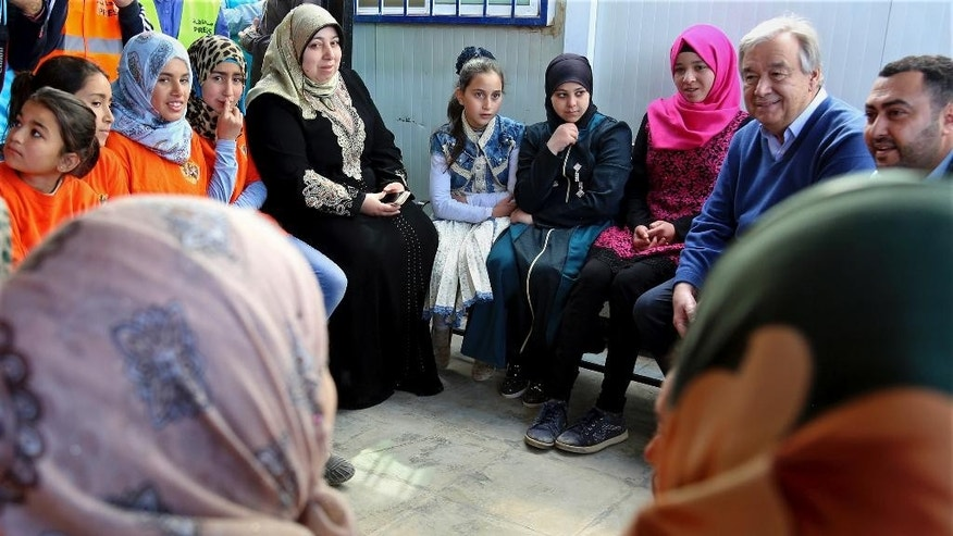 U.N. Secretary General Antonio Guterres, second left, visits the U.N.-run Zaatari camp for Syrian refugees, in northern Jordan, Tuesday, March 28, 2017. Guterres appealed to Arab states to overcome their divisions on Syria and help end the country's six-year-old civil war. The U.N. chief is to attend an annual Arab Summit in Jordan on Wednesday. (AP Photo/Raad Adayleh)