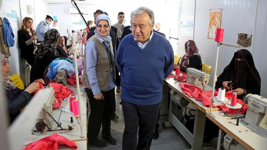 U.N. Secretary General Antonio Guterres visits the U.N.-run Zaatari camp for Syrian refugees, in northern Jordan, Tuesday, March 28, 2017. Guterres appealed to Arab states to overcome their divisions on Syria and help end the country's six-year-old civil war. The U.N. chief is to attend an annual Arab Summit in Jordan on Wednesday. (AP Photo/Raad Adayleh)