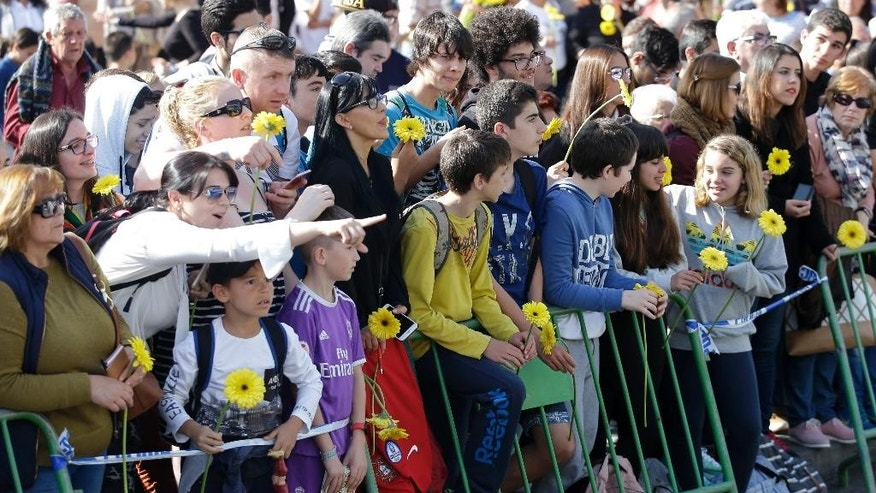 Fans wait at the Madeira international airport outside Funchal, the capital of Madeira island, Portugal, Wednesday March 29, 2017. Madeira International Airport will be renamed after local soccer star Cristiano Ronaldo on Wednesday during a ceremony, with family at the airport outside his Funchal hometown. (AP Photo/Armando Franca)