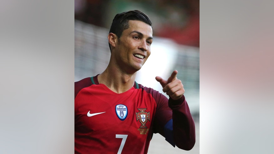 Portugal's Cristiano Ronaldo reacts during the international friendly soccer match between Portugal and Sweden at the dos Barreiros stadium in Funchal, Madeira island, Portugal, Tuesday, March 28 2017. (AP Photo/Armando Franca)