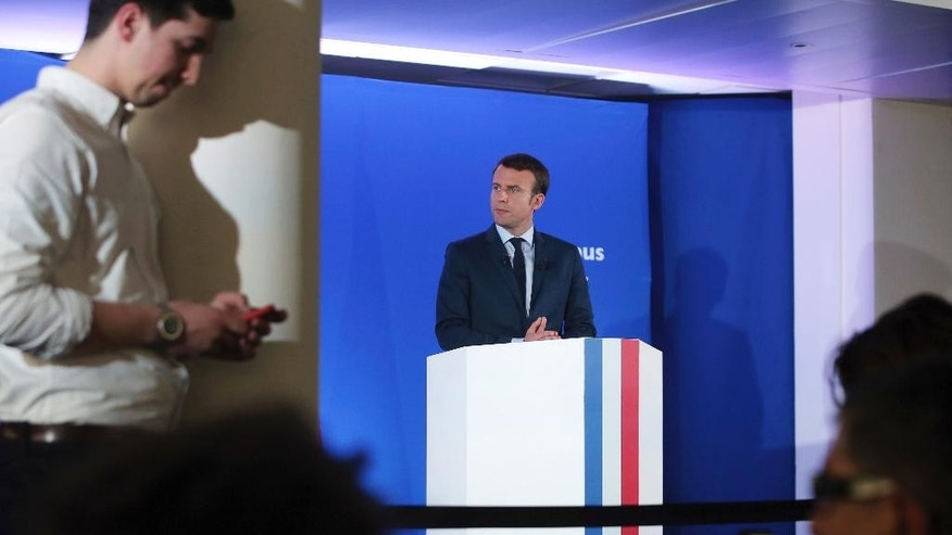Candidate for the 2017 presidential election Emmanuel Macron, center, gives a press conference, in Paris, Tuesday, March 28, 2017. Macron, an independent centrist with pro-free market views, is fiercely promoting common European ideals of peace, prosperity and freedom with a blitz of campaign events across France and Europe to explain to voters why the EU matters. (AP Photo/Thibault Camus)