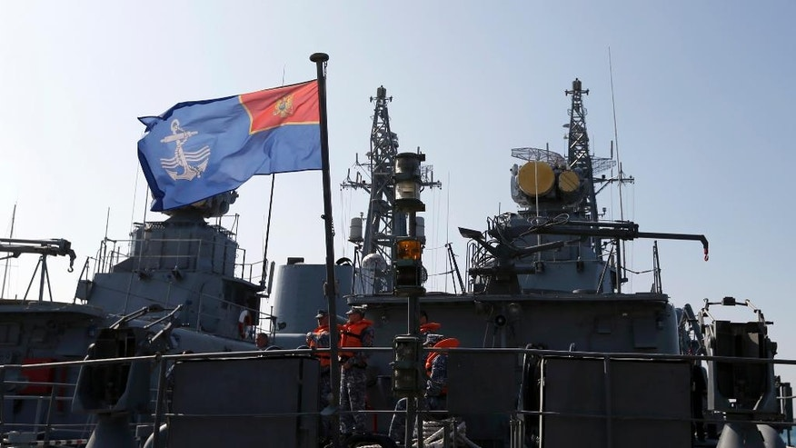 "FILE - In this March 15, 2017, file photo, Montenegrin sailors stand at the light frigate ""Kotor"" in the harbour of Bar, Montenegro. Montenegro is set to become NATO's newest member after the Senate voted overwhelmingly March 28 to ratify the tiny Balkan nation's entry into the alliance. Despite its size, Montenegro bears strategic importance. A former ally of Russia, the country is in the midst of a clash between the West and Moscow over influence in the Balkans. Montenegro will become the 29th member of the alliance and its admission gives NATO a contiguous border along the Adriatic coast. (AP Photo/Darko Vojinovic)"
