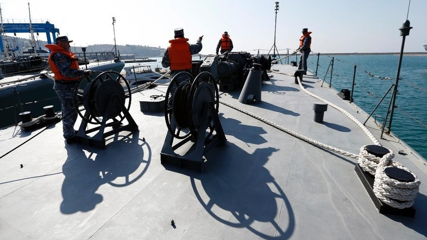"In this Wednesday, March 15, 2017 photo, Montenegrin sailors prepare light frigate ""Kotor"" for sailing, in the harbour of Bar, Montenegro. Montenegro officials have welcomed U.S. Senate's decision to ratify its entry into NATO, calling it a great day for the tiny Balkan nation. (AP Photo/Darko Vojinovic)"