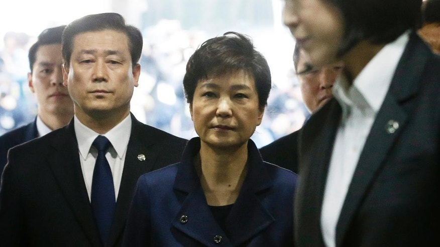 Ousted South Korean President Park Geun-hye, center, arrives at the Seoul Central District Court for hearing on a prosecutors' request for her arrest for corruption, in Seoul, South Korea, Thursday, March 30, 2017. (AP Photo/Ahn Young-joon. Pool).