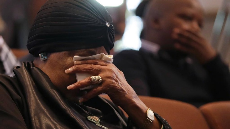Former wife of the late former President Nelson Mandela, Winnie Madikizela-Mandela, listens to speeches during the memorial service for Ahmed Kathrada, at the Nelson Mandela Foundation in Johannesburg, South Africa, Tuesday, March 28, 2017. Anti-apartheid activist Ahmed Kathrada, who spent 26 years in jail - many of them alongside Nelson Mandela - for working to end South Africa's previous white minority rule, died in Johannesburg on Tuesday morning. He was 87 years old. (AP Photo/Themba Hadebe)
