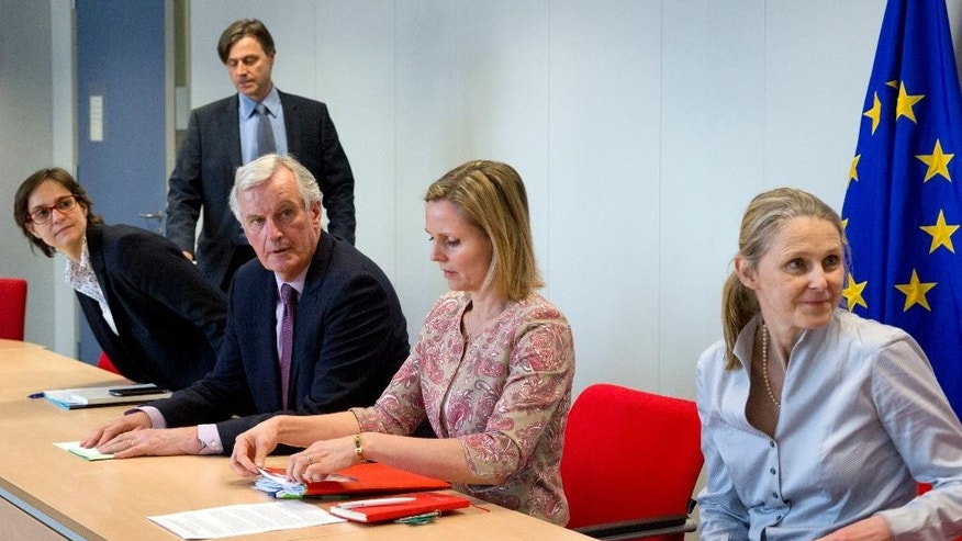 European Chief Negotiator for Brexit Michel Barnier, third left, meets with members of 'The 3 Million' at EU headquarters in Brussels on Tuesday, March 28, 2017. The group is calling on the Government to unilaterally guarantee the rights of EU citizens in the UK post-Brexit. (AP Photo/Virginia Mayo)