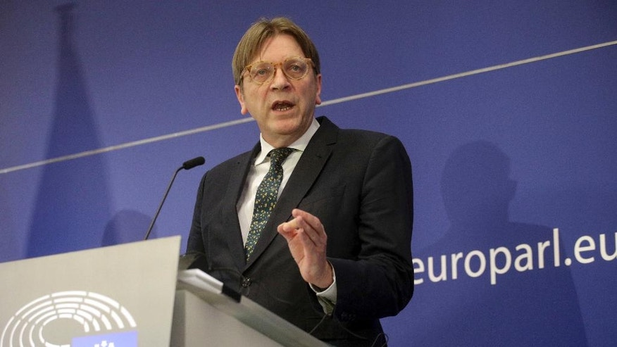 Leader of the ALDE Guy Verhofstadt speaks during a media conference at the European Parliament in Brussels on Wednesday, March 29, 2017. EU Council President Donald Tusk on Wednesday received a letter from British Prime Minister Theresa May, invoking Article 50 of the bloc's key treaty, the formal start of exit negotiations. (AP Photo/Olivier Matthys)