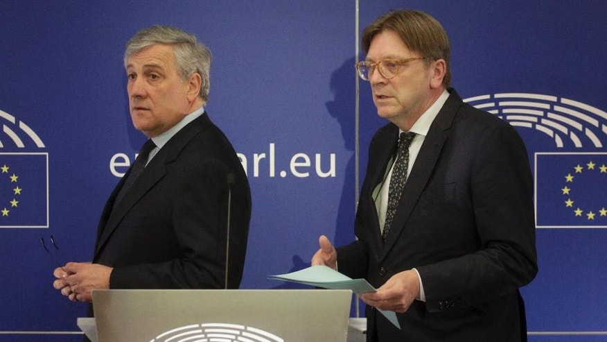European Parliament President Antonio Tajani, left, and leader of the ALDE party Guy Verhofstadt prepare to address a media conference at the European Parliament in Brussels on Wednesday, March 29, 2017. EU Council President Donald Tusk on Wednesday received a letter from British Prime Minister Theresa May, invoking Article 50 of the bloc's key treaty, the formal start of exit negotiations. (AP Photo/Olivier Matthys)