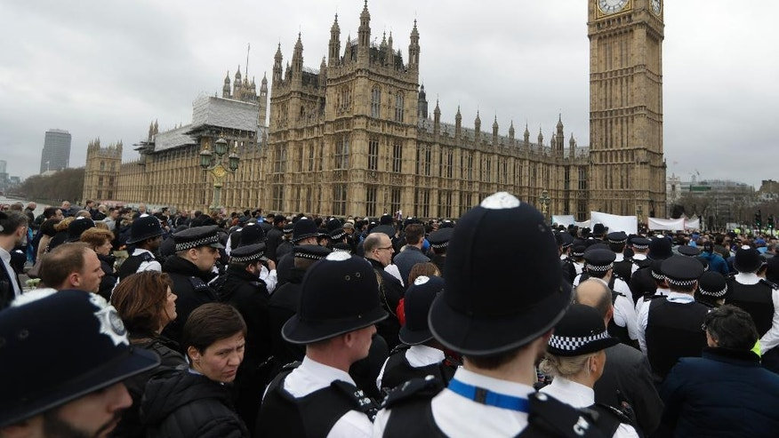 Police officers take part in a commemorative event to mark last week's attack outside Parliament that killed four people on Westminster Bridge in London, Wednesday, March 29, 2017. (AP Photo/Matt Dunham)