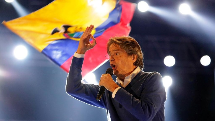 Guillermo Lasso, presidential candidate for the CREO political party addresses the crowd during his closing campaign event ahead of Sunday's presidential runoff election in Quito, Ecuador, Wednesday, March 29, 2017. (AP Photo/Dolores Ochoa)