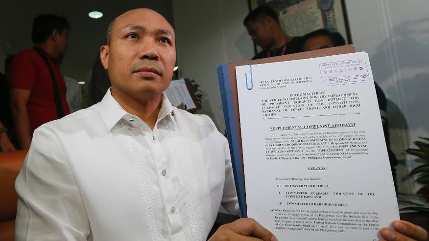 "Congressman Gary Alejano shows to the media the supplemental impeachment complaint he filed against President Rodrigo Duterte Thursday, March 30, 2017 at the Lower House in suburban Quezon city northeast of Manila, Philippines. Alejano, who cited in his earlier March 16, 2017 complaint, the thousands of deaths that have happened in Duterte's anti-drug crackdown as well as his alleged corruption, filed a supplemental impeachment complaint Thursday allegedly ""for failure to assert the Philippines' exclusive sovereign rights over the Benham Rise, and his refusal to raise the issue over the plan of China to construct an environmental monitoring station in the disputed Scarborough Shoal.""(AP Photo/Bullit Marquez)"