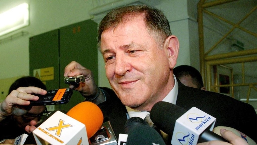 FILE- In this Saturday April 17, 2004 file photo, the then Slovak presidential candidate and former Prime Minister Vladimir Meciar speaks to the media after casting his vote during elections in downtown Bratislava, Slovakia. Slovakia's parliament has started to debate a proposal to annul pardons by former authoritarian Prime Minister Vladimir Meciar that prevent an investigation into the kidnapping of the son of late President Michal Kovac, Meciar's political archrival. A vote is expected on Thursday, March 30, 2017. (AP Photo/Petr David Josek, File)
