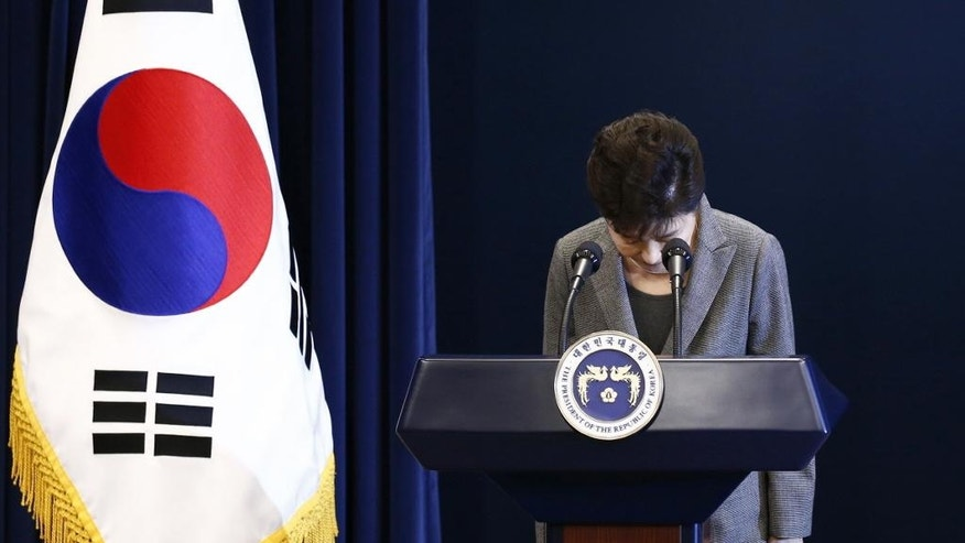 FILE - In this Nov. 29, 2016 file photo, then South Korean President Park Geun-hye bows during her address to the nation at the presidential Blue House in Seoul, South Korea. The arrest of South Korea's first female president marks a stunning fall for the scion of a powerful general who himself ruled the country during her teenage years and into her 20s. Park was jailed Friday, March 31, 2017,  three weeks after the Constitutional Court stripped her of office over a corruption scandal. Prosecutors accuse her of colluding with a jailed confidante to amass an illicit fortune and allowing the friend to manipulate state affairs. (Pool Photo via AP, File)