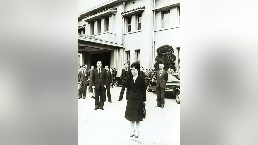 In this Nov. 21, 1979 photo, Park Geun-hye leaves after her father, former president Park Chung-hee's state funeral at the presidential Blue House in Seoul, South Korea.  The arrest of South Korea's first female president marks a stunning fall for the scion of a powerful general who himself ruled the country during her teenage years and into her 20s. Park was jailed Friday, March 31, 2017,  three weeks after the Constitutional Court stripped her of office over a corruption scandal. Prosecutors accuse her of colluding with a jailed confidante to amass an illicit fortune and allowing the friend to manipulate state affairs.  (Yonhap via AP)