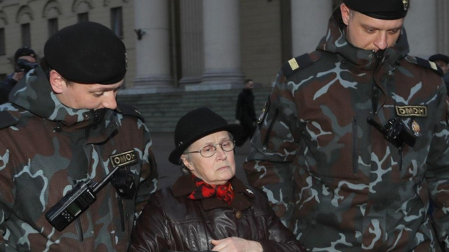 Police officers detain opposition activist, Nina Baginskaya, center,  prior to a protest in Minsk, Belarus, Friday, March 31, 2017. Four people have been detained in Minsk during an attempt to protest against political repression. (AP Photo/Sergei Grits)