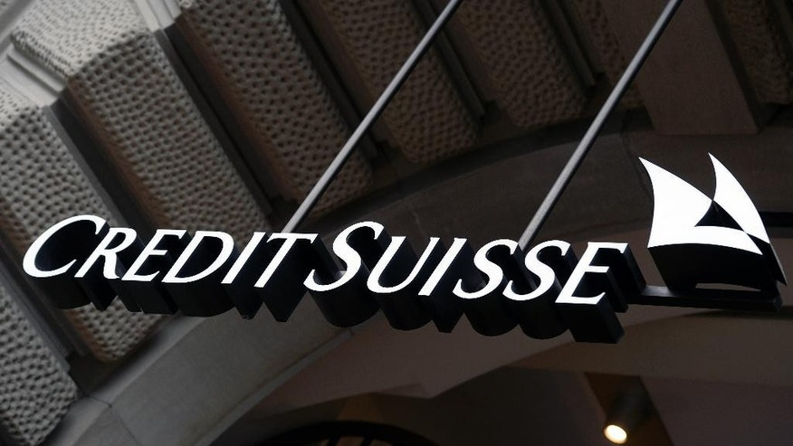 FILE - This Oct. 21, 2015 file photo shows the logo of the Swiss bank Credit Suisse, in Zurich, Switzerland. European authorities are investigating dozens of people suspected of tax evasion involving Swiss bank Credit Suisse, officials said Friday, March 31, 2017. Dutch authorities in particular said they had detained two people and seized assets including luxury cars, paintings and even a gold bar in the multi-country sweep. (Walter Bieri/Keystone via AP, file)