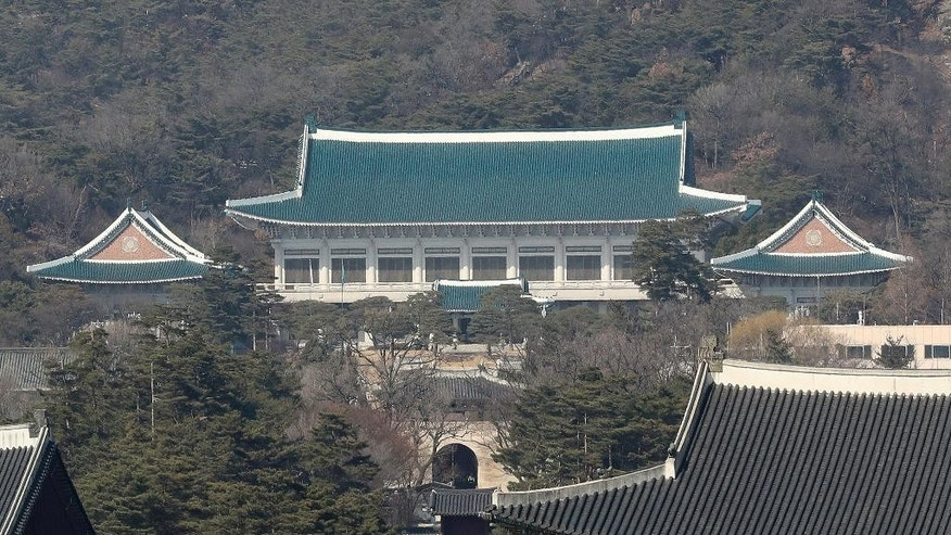 FILE - This Friday, March 10, 2017 file photo shows the presidential Blue House in Seoul, South Korea. For a person whose life always seemed to revolve around South Korea's huge presidential palace, the next several months will be lived on a much smaller scale. Park Geun-hye entered the Seoul Detention Center in a black sedan before dawn Friday, March 31, 2017, after a court approved her arrest on corruption allegations. (AP Photo/Lee Jin-man, File)