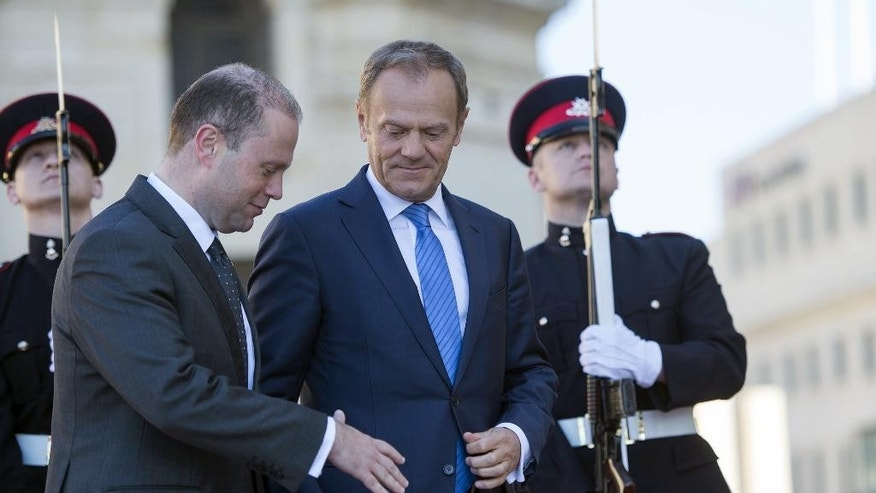 President of the European Council Donald Tusk, right, is greeted by the Maltese Prime Minister Joseph Muscat ahead of their joint press conference on the EU guidelines for Brexit talks, outside the Premier's office Castille, in Valletta, Malta, Friday, March 31, 2017. The guidelines that Tusk is putting to EU members make it clear that withdrawal from the bloc comes ahead of any new relationship with Britain even though the rough outlines such a relationship may partially overlap. (AP Photo/Rene Rossignaud)
