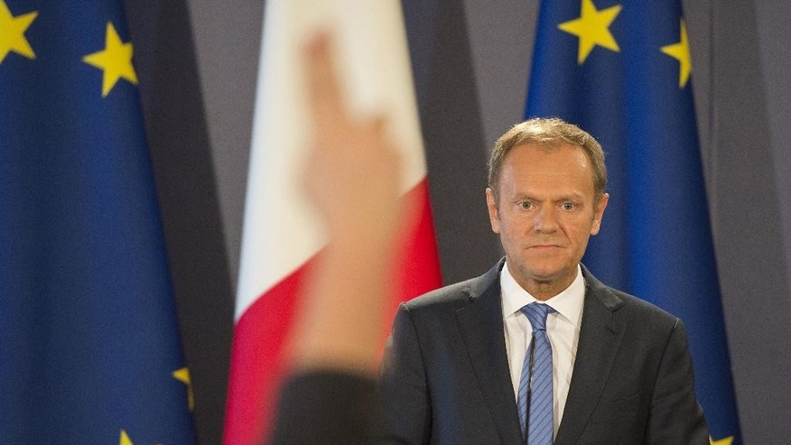 President of the European Council Donald Tusk attends a joint press conference in Valletta, Malta, Friday, March 31, 2017. Tusk insisted Friday after a meeting in Malta that withdrawal from the bloc comes ahead of any new relationship with Britain. But he also said the EU will not punish the U.K. in the exit talks, and that the so-called Brexit is punitive enough. (AP Photo/Rene Rossignaud)