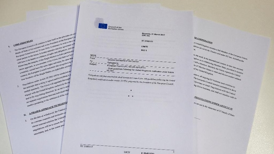 A copy of draft guidelines from the EU on the subject of Britain's invoking of Article 50 which were obtained by the Associated Press Friday March 31, 2017. The European Union softened its line on Britain's exit from the bloc Friday, with Council President Donald Tusk signaling some flexibility on allowing talks on a new relationship before the divorce proceedings are complete. (AP Photo/Sam Wells)