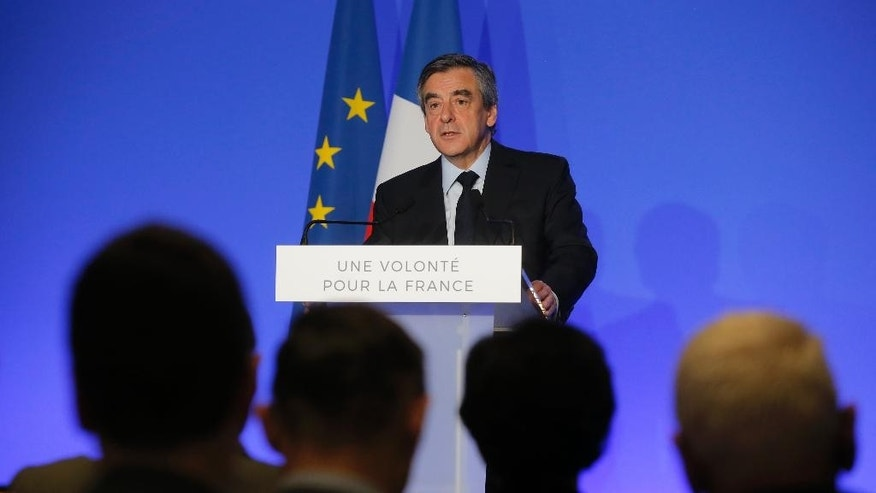 French conservative presidential candidate Francois Fillon speaks on defense policy, Friday, March 31, 2017 in Paris. Two leading French presidential candidates lay out their plans for defense and foreign policy, with the country under a state of emergency after extremist attacks. (AP Photo/Michel Euler)