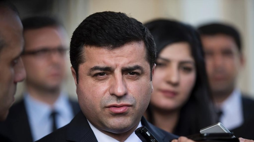 FILE- In this Monday, Feb. 15, 2016 file photo, Turkish co-chairman of pro-Kurdish People's Democratic Party, or HDP, Selahattin Demirtas speaks with journalists after his meeting with Greek Prime Minister Alexis Tsipras, in Athens. The jailed leader of Turkey's pro-Kurdish party says he is embarking on a hunger strike to protest prison conditions, he said in a statement released by his party on Friday, March, 31, 2017. (AP Photo/Petros Giannakouris, File)
