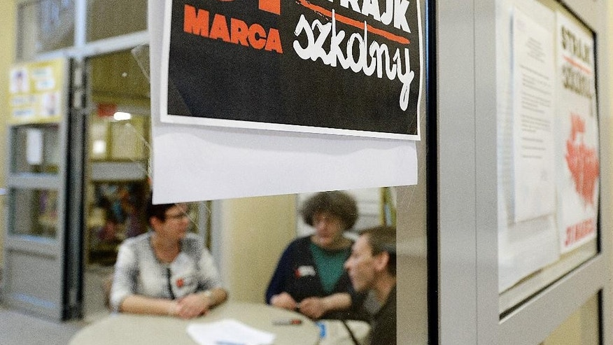 "A poster at  the door in a school  reeads:   ""School Strike March 31"" in Warsaw, Poland, on Friday March 31, 2017. Teachers across Poland staged a strike Friday to protest a sweeping overhaul of the education system by the populist government that will see middle schools eliminated this coming fall.  (AP Photo/Czarek Sokolowski)"
