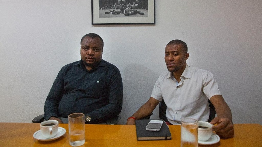 "In this Thursday, March 30, 2017 photo, Samuel Jack, left, president of the African Students' Association, and Ezeugo Nnamdi Lawrence, a coordinator of African students, sit for an interview with The Associated Press in New Delhi, India. Tens of thousands of Africans live and study in India, drawn by better education and work opportunities. But racism and prejudice is a daily battle for Africans across India. ""We face street aggression, abuses. We also face difficulty in getting accommodation, we face difficulty in naturally integrating with the local community,"" said Samuel Jack. (AP Photo/Manish Swarup)"