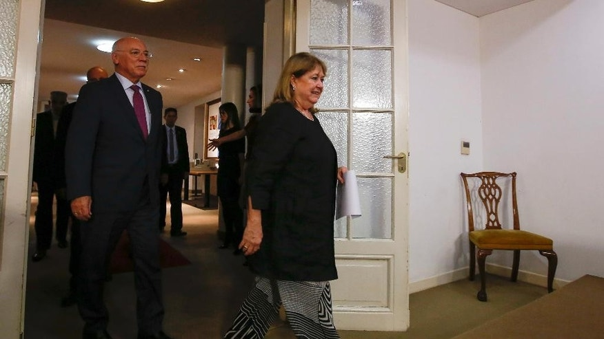Argentina's Foreign Minister, Susana Malcorra, center, and Paraguay's Foreign Minister Eladio Loizaga arrive to a press conference in Buenos Aires, Argentina, Saturday, April 1, 2017. The South American trade bloc called an emergency meeting of Mercosur nations' foreign ministers to discuss the Venezuelan political crisis which suspended Venezuela in December. (AP Photo/Agustin Marcarian)