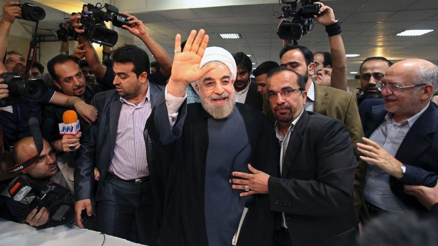 "FILE-In this file photo taken on Tuesday, May 7, 2013, Hassan Rouhani waves, as he arrives at the interior ministry to register his candidacy for presidential election, in Tehran, Iran. Iran's hard-liners are hoping they can benefit from the election of U.S. President Donald Trump, arguing that their own country needs a tougher leader to stand up to an American president whose administration has put the Islamic Republic ""on notice.""(AP Photo/Vahid Salemi, File)"