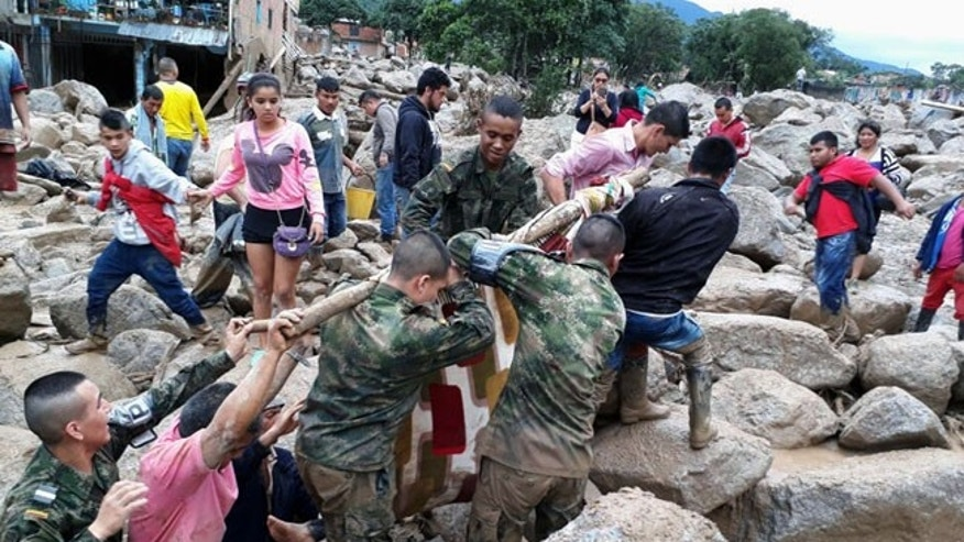 Soldiers and residents work together in rescue efforts in Mocoa, Colombia, on Saturday, April 1, 2017.