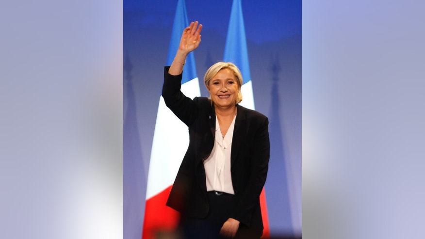 Far-right candidate for the presidential election Marine Le Pen waves at supporters after she delivers a speech during a meeting in Bordeaux, southwestern France, Sunday, April 2, 2017. Polls suggest that Le Pen and independent centrist Emmanuel Macron are the two top contenders in the election. The top two vote-getters on April 23 will compete in a presidential runoff on May 7. (AP Photo/Bob Edme)