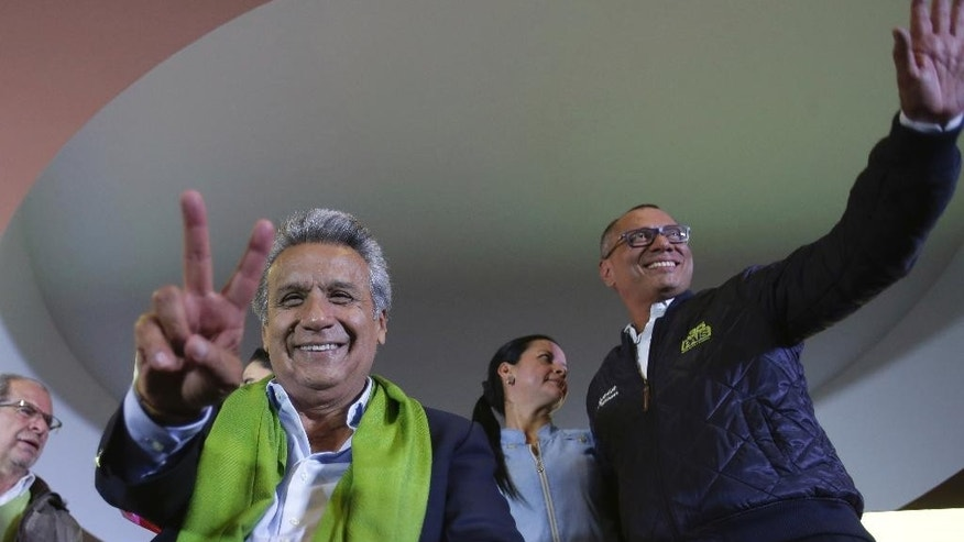 Alianza PAIS's presidential candidate Lenin Moreno, left, and his running mate Jorge Glas smile end of the day of the presidential election, in Quito, Ecuador, Sunday, April 2, 2017. Ecuador went to the polls in a second round presidential elections. (AP Photo/Dolores Ochoa)